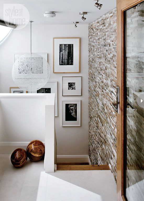 A barely-there pendant light by Moooi makes a big but subtle statement in this stairwell. {PHOTO: Donna Griffith}