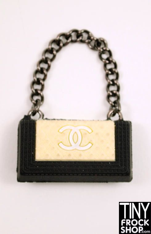 Oh how we covet Chanel! Now you can get a Chanel Boy bag for Barbie! In 3 colors with gun metal chain strap. Collect all three! 1:6 Scale. (rubber - does not open). No longer being made. HARD TO FIND.