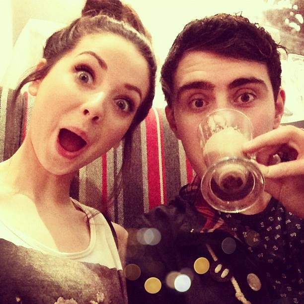 Zoella and Alfie drinking his hot chocolate <3