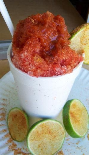 Chamoyada - delicioso!  (mexican snow cone - chamoy and lime. Chamoy refers to a variety of savory sauces and condiments in Mexican cuisine made from pickled fruit. Chamoy may range from a liquid to a paste consistency, and typically its flavor is salty, sweet, sour and spiced with powdered chiles all at the same time.)