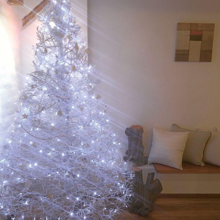 White Christmas tree, white lights, white ornaments. White over white