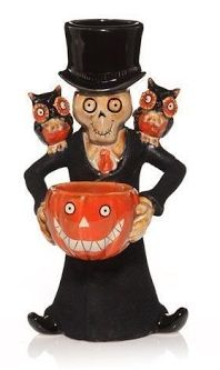 "Boney Bunch 2010 ""Hoot Gravely"" Multi Tea Light Holder  Boney Bunch 2010 character named Hoot Gravely is a multi tea light holder approx. 8 inches tall. He holds 2 tea lights: one in his hat and the other in the ever so popular Boney Bunch jack-O-lantern that he holds. Two cute owls adorn his shoulders. Hoot is backstamped BONEY BUNCH 2010, designed by Mark Cook, and has a paper label reading Yankee Candle."