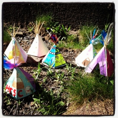 Tepees, collect sticks, make a template for the outside, so all they have to do is cut and color.  I think camper would love this.
