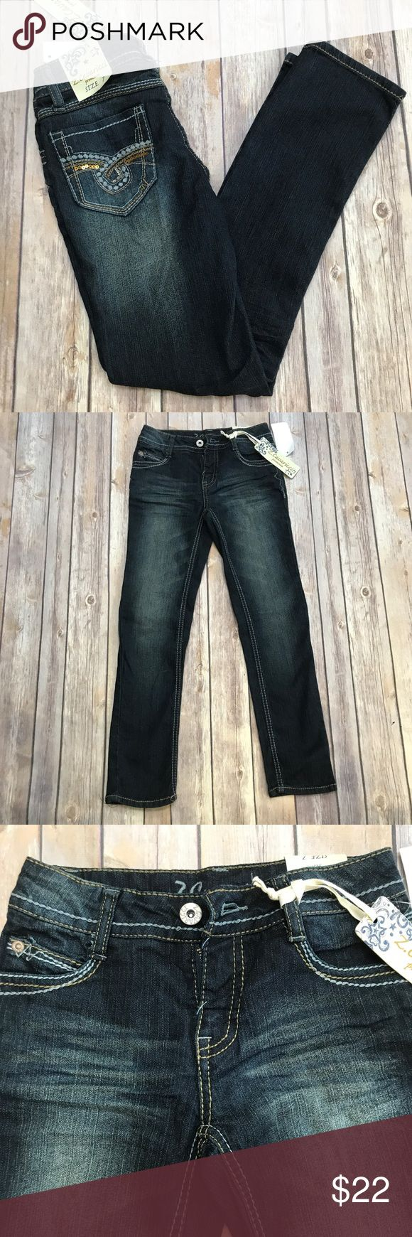 NWT- Girls Z-Cavaricci Jeans, Size 7 Girls whiskered soft & stretchy jean material. Dark wash, double stitching, button closure/ zipper front. Super cute back pocket detail, trendy fit. NWT (New With Tags) Z-Cavarrici Bottoms Jeans