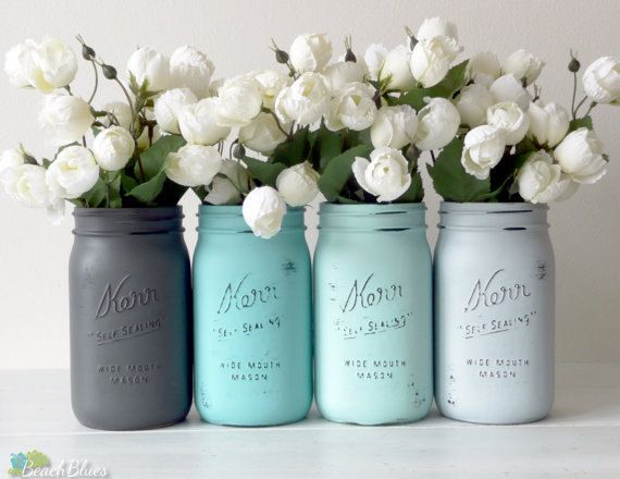 FEATURED IN ETSY SUCCESS EMAIL !  This listing is for 4 quart size jars (6 1/2 tall) for $32. The colors are dark grey, turquoise, aqua and light grey. All jars come with lids.  I pride myself in creating unique colors and styles of painted and distressed shabby chic mason jars. Beach Blues is the home of the original! This is a unique and one of a kind color combination and title created by me. These jars are painted only on the outside. They are sprayed with a a…
