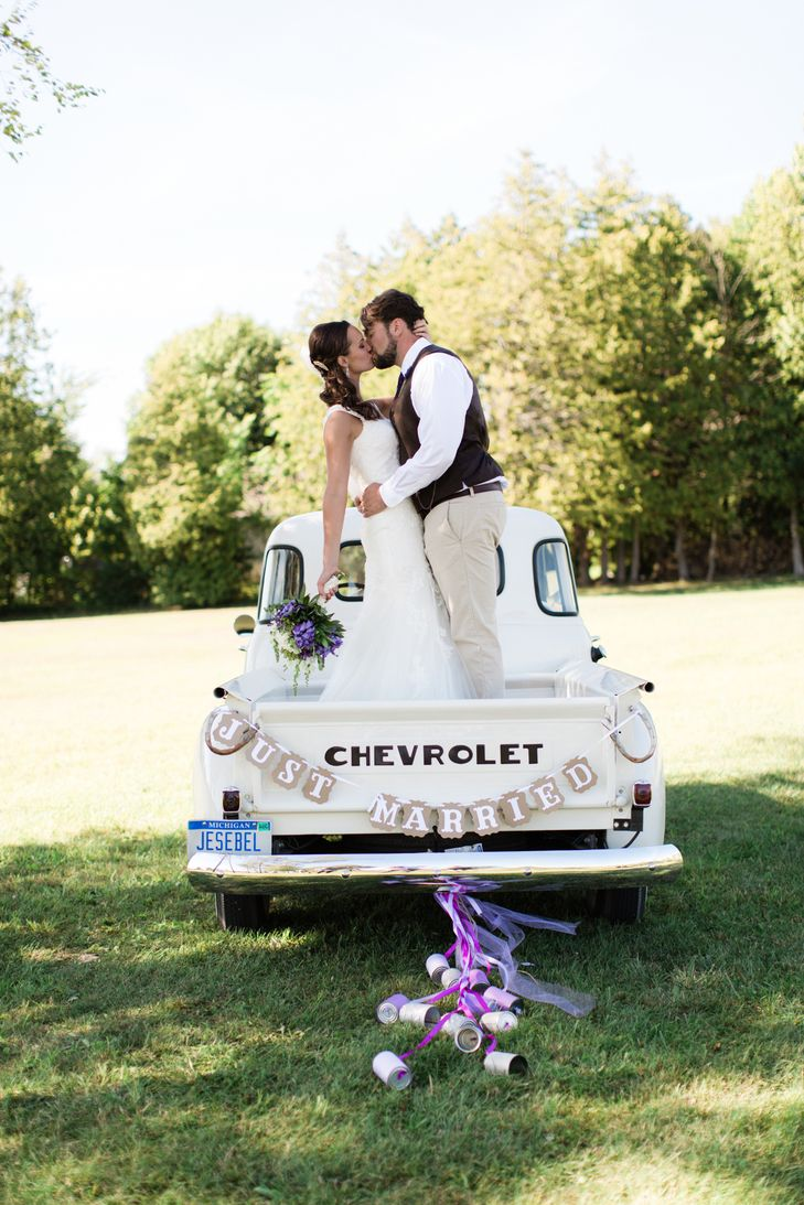 Romantic Moment on Rustic Classic Truck | Bella Bianca Bridal Collection | Captain's Quarters | Impres Salon | A Day In May, Event Planning & Design | Dan and Melissa Photogrpahy https://www.theknot.com/marketplace/dan-and-melissa-photography-traverse-city-mi-609345