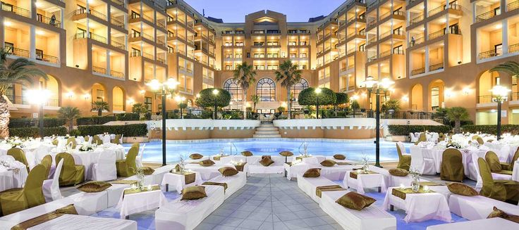 The Corinhia Hotel in St. George's Bay, Malta. The perfect place where you can have a Dinner by the pool looking at the Sea.
