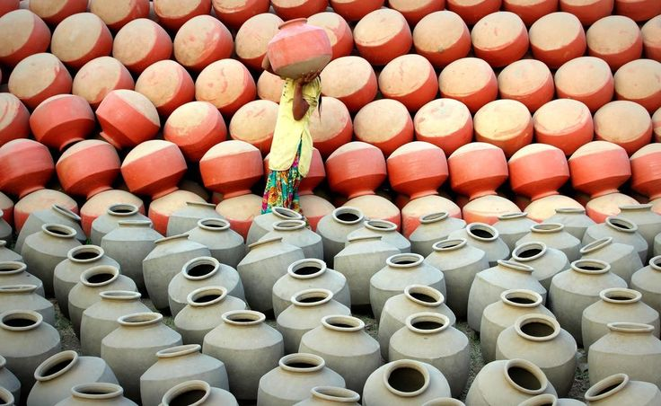 """In India , people uses clay pots at their home to store drinking water. These pots are usually handmade without using any big machinery.These small business of making pots are run at home level. All family members participate at one or another stage of the pot making. This process have various stages to convert raw clay to finished colored pot which is also called """"Mitti ka gadha."""""""