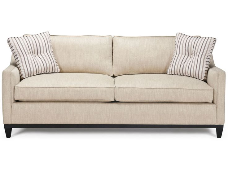 The Nichol Collection features clean, modern lines with elegantly sloping track arms, high tapered leg base and box back cushions.  Deep two-cushion seating and ample proportions make for an ultra comfortable sofa. The sofa comes with 2 box button toss pillows.