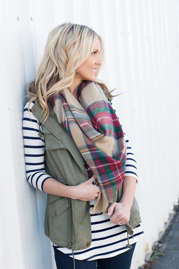 These military style vests are a must have for your fall and winter wardrobe. Vest features a detachable hood, two chest pockets, a cinch waist, and two side pockets.  Winter is all about layering and the possibilities are endless with this cute vest!100% Cotton.SIZES: Small (0-4)Medium (6-8)Large (10-12)X-Large (12-14)Model is wearing a size small.