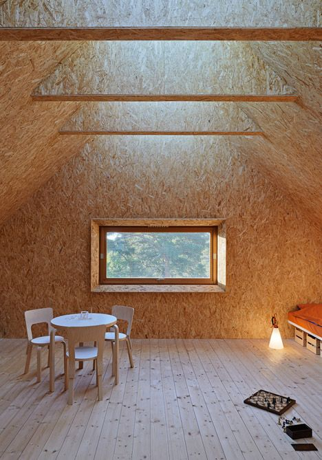 Behind the black steel exterior of this home on the Stockholm archipelago, Tham & Videgård Arkitekter has created a living space with vaulted ceilings, and bedrooms with one big skylight overhead.