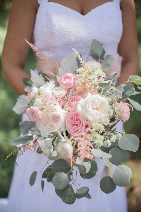 If you've been dreaming of a rustic wedding since you were a little girl, then this Georgia wedding is for you. FromJL Designs' bouquet masterpiece filled with ranunculus, astilbe, roses and eucalyptus to the romantic ceremony in the woods, this