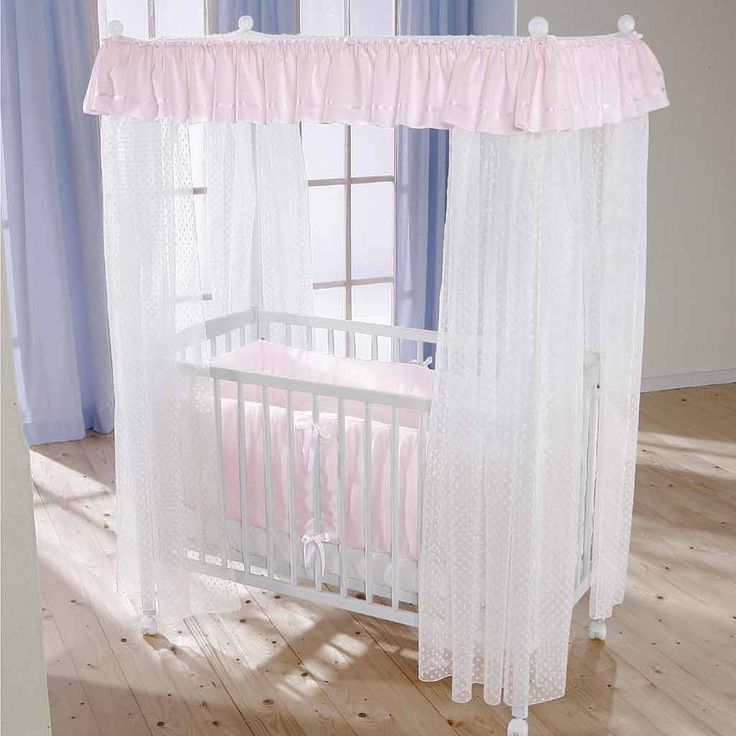 White Wooden Baby Crib with Soft White Bedding Accessories and Transparent Style Curtain that have Pink Upper Curtain for Baby Nursery Crib Decorating with Canopy