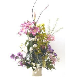 ¡Este centro es un verdadero jardín de flores de lujo! Contiene orquídeas, cymbidium, lilium, nerrines, freesia, flox, hortensias, proteas y astromelias | Bourguignon Floristas