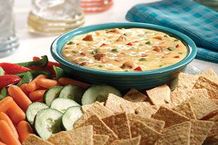 Cream cheese, canned crabmeat, Parmesan, green onions, wine, horseradish and hot pepper sauce are blended and baked into a savory hot appetizer dip.