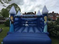 This frozen themed Bouncy Castle is our most popular castle with the girls and is a good choice if your looking for a great castle for your little princess . This castle does not come with a rain cover and it's suitable for up to 6-8 children at a time. The front panels feature hand painted images of Elsa and Anna , the back wall features and hand painted image of Ola