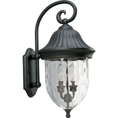 capture the romance with this twolight wall lantern from the coventry collection that features optic hammered glass stylized cap and hook
