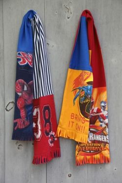 Recycled t-shirt patchwork scarfs are made from old graphic t-shirts that have no longer any use as a shirt. The shirts are cut in strips to show...
