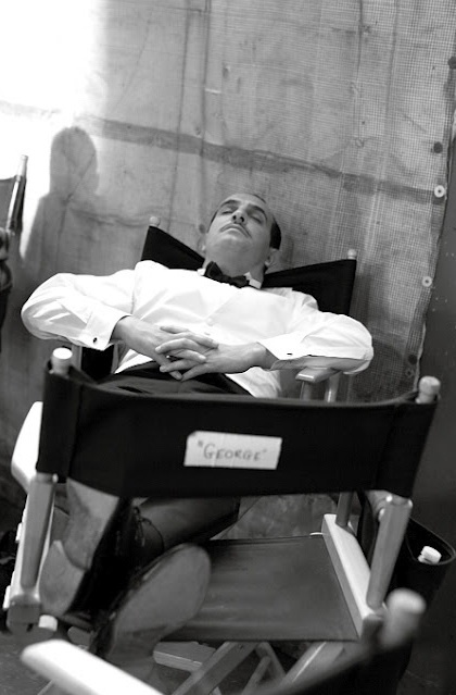 Jean Dujardin taking a nap on the set of The Artist