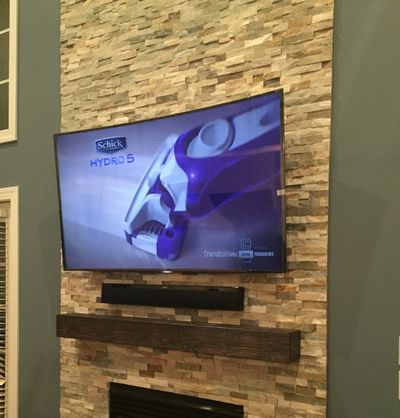 Charlotte TV wall mounting services, Carolina Custom Mounts professional TV mounting service, home theater, HD antenna installations