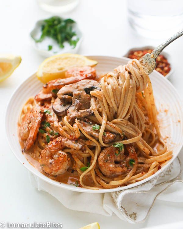 One-Pot Creamy Jerk Shrimp Spaghetti is filled with mushrooms and covered in a #spicy & creamy jerk sauce.