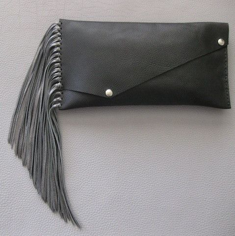 "Jessica Clutch $130.00 Super soft leather clutch. Hand cut, hand sewn and made with love. The purse is 13"" x 6.5"" and hangs 30"" long, including the fringe. The fringe itself is 10"" long (and can be totally customized to a shorter length if desired). And, how cool is this....the handle is detachable so you can swing it around or carry it under your arm."