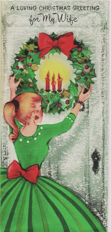 A young woman in a holiday dress hangs a wreath in this Vintage Christmas card for a wife by American Greetings.