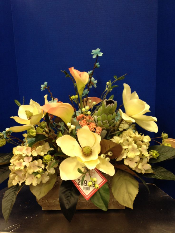Calla, magnolia , and hydrangea arrangement