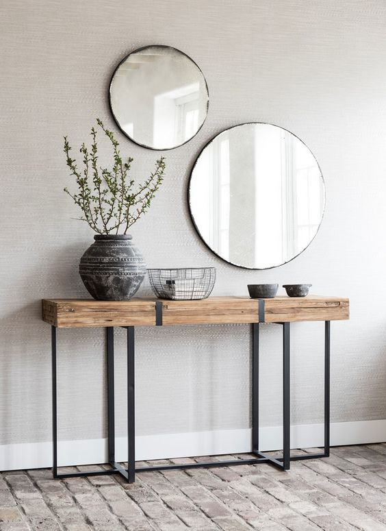 a duo of round mirrors in simple frames for a boho…
