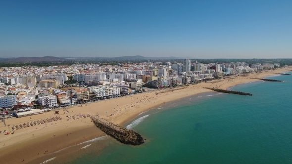 Breakwaters and Quarteira Beach Filmed From the Sky by sergofoto Aerial. Breakwaters and Quarteira beach filmed from the sky. Algarve Portugal