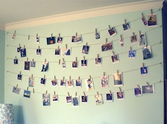 D.I.Y. Photo Display -- Use a string (or even string lights) && clothespins to hang your favorite photos/memorabilia in a criss-cross fashion on your wall, for a nice, (somewhat) neat display of your keepsakes & memorabilia.
