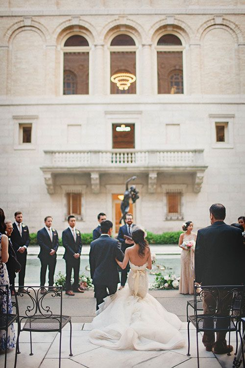 Intimate East-Meets-West Boston Wedding, Bride Walking Down the Aisle | Brides.com | Photo: Katch Studios