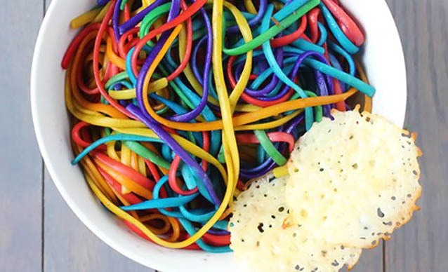 Coloured spagetti :)....  Place a drop or two of food colouring in Baggie, add a scoopful of cooked  spagetti,  swish around.  Repeat with a as many different colours you want.   Kids will love it!