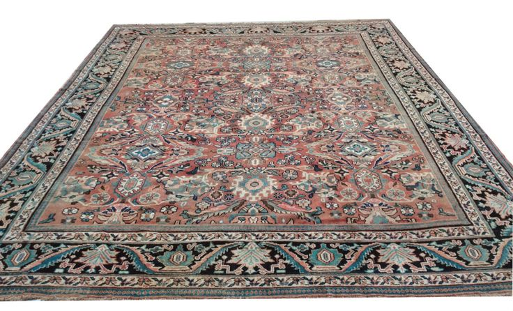 This antique Mahal rug was handmade and hand knotted from wool and showcases beautiful traditional Persian motifs; 10.3' x 13'. Mahal Persian carpet design.