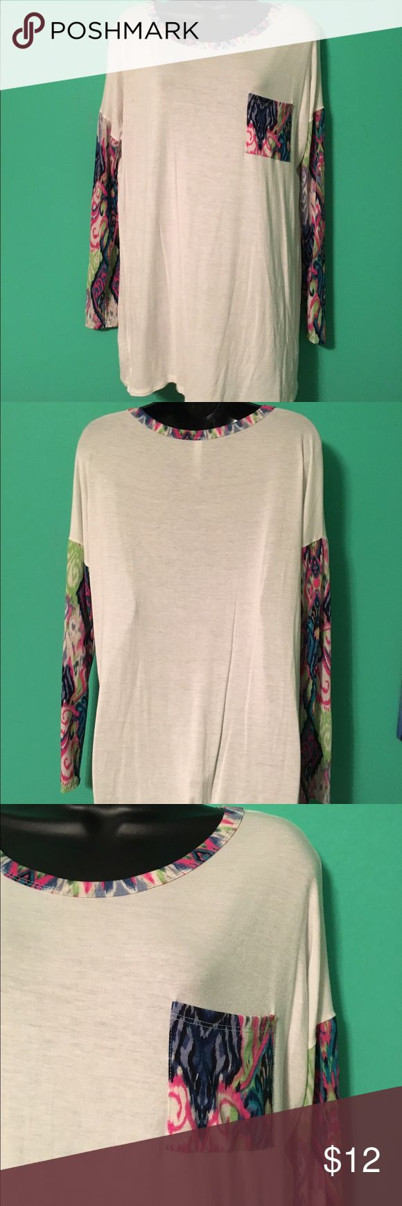 Cream Tee with Bright Printed Sleeves and Pocket Cute, stretchy, cotton-feeing top with bright accent sleeves. 96% rayon, 4% spandex. Tops Tees - Long Sleeve