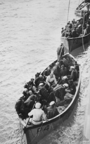 27th November, 1941. Eight days after the Battle between HMAS Sydney and the German Kormoran, German lifeboats with survivors are towed to shore by the British Merchant Vessel Centaur. No Australians survived.