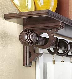 place a shelf over the window to hold the curtain rod; leaves you room for placing decor and makes it an interesting take on the normal curtain rod