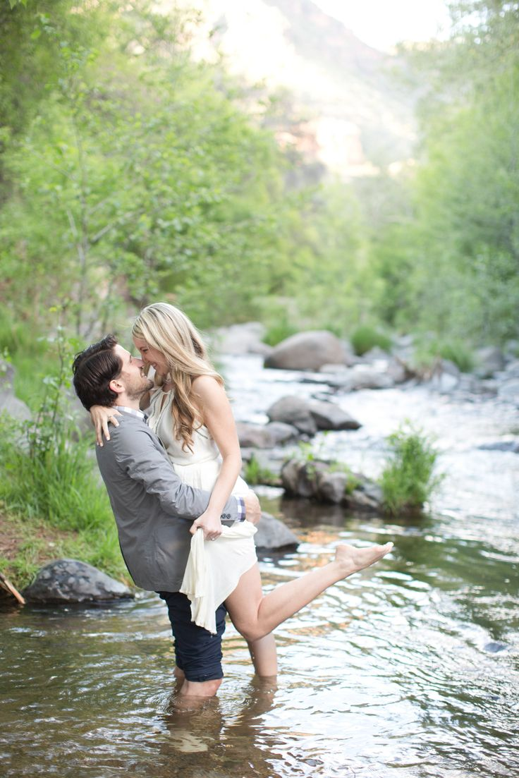 Engagement session in the woods of Sedona, Arizona, along a beautiful creek. Barefoot, long blush dress.