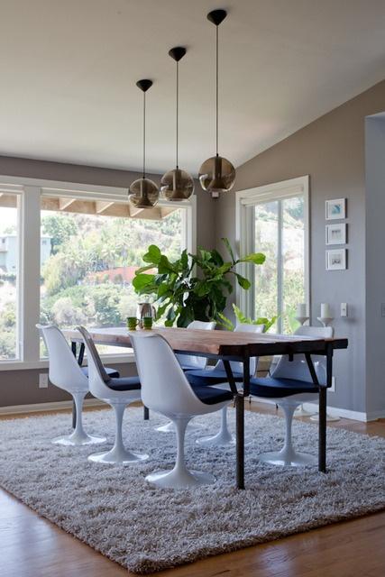 wood/metal table, windows, pendant lights (vintage Raak) (via Apartment Therapy)