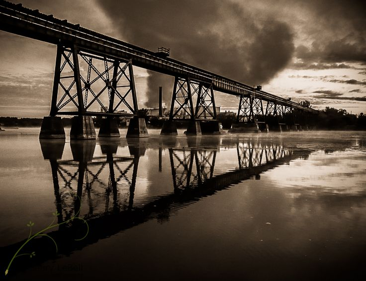 Iron bridge over the Trent River in Trenton, Ontario with Norampac Mill as a backdrop - http://www.lebell.ca/iron-bridge-trenton-ontario-trent-river-norampac-mill/ bridge, iron bridge, Mill, Norampac, Quinte West, River, train bridge, Trent River, Trent-Severn Waterway, Trenton