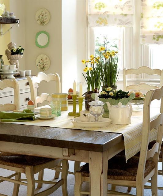 love the table and chairs, daffodils, all that cream with greens and yellow. This is my take on country shabby chic.