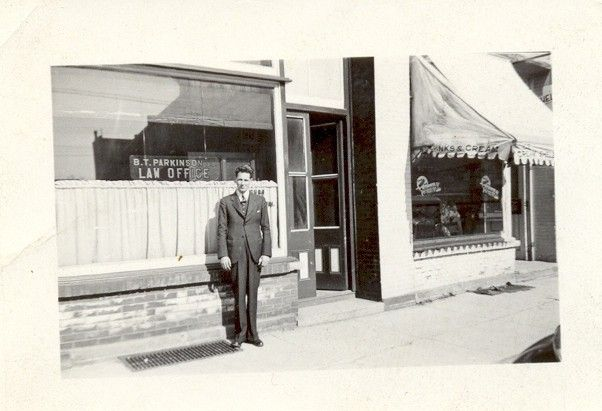Boris R. Parkingson, for whom the Parkinson Centennial Public School (1968) was named, was the chairman of the Upper Grand School Board. He went to school for law which he practiced in Orangeville, as can be seen in this photo in front of his office at 143-145 Broadway. Boris passed away at the age of 83 in January 1991.