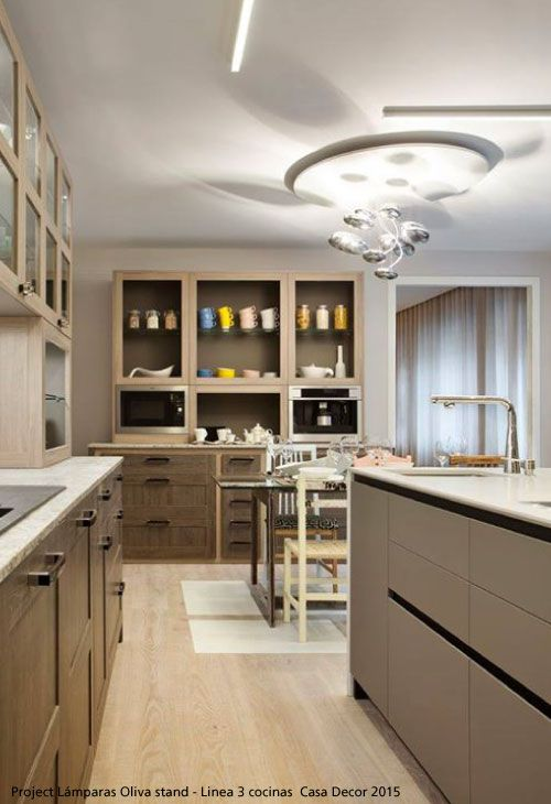 The kitchen, the place where the best stories of a family and a house are written ; with good lighting, it can be enjoyed even more! #Mercury Ceiling #Design Ross Lovegrove