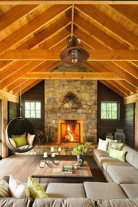 Wooden roof, stone fireplace and a comfortable hanging chair for cozy autumn afternoons....