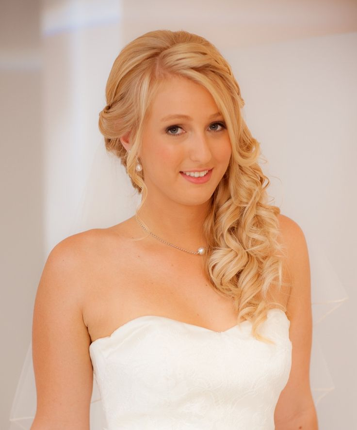 Stunning Bride with curls to one side by Total Brides hair & makeup