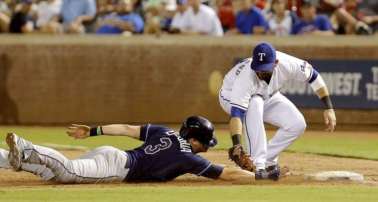 Dead meat -  First baseman Mitch Moreland of the Texas Rangers tags out Evan Longoria of the Tampa Bay Rays during the seventh inning Aug. 15 in Arlington, Texas. The Rangers won 12-4. -  © Brandon Wade/Getty Images