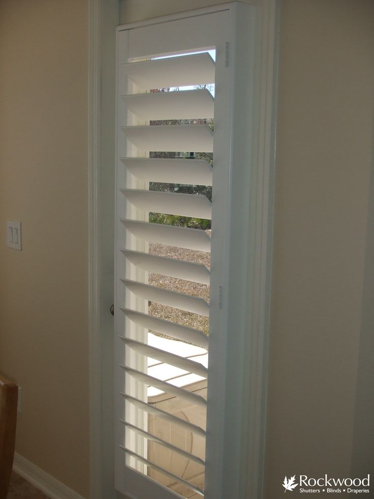 White Shutters On A French Door From Rockwood Shutters