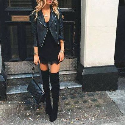 This outfit! Love the lace and the leather combo, with just a smidge of thigh showing. Very edgy + chic.
