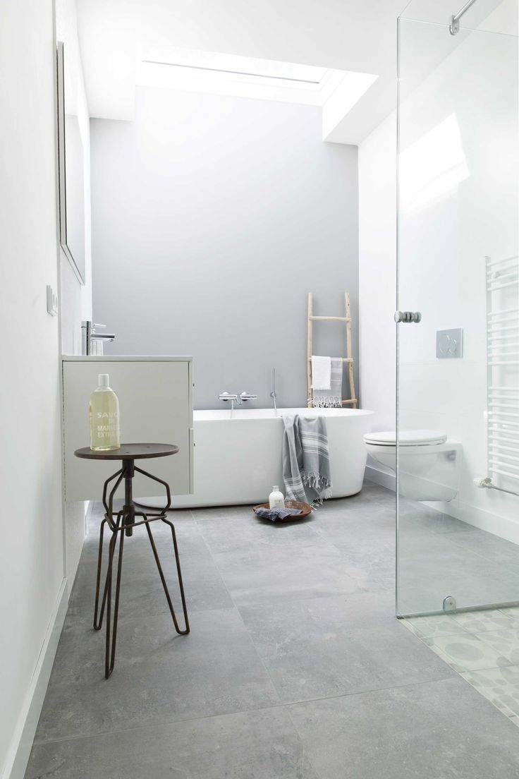 Neutral white bathroom with large grey tiled flooring