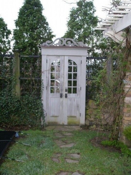 Vintage doors used as a garden gate....love.